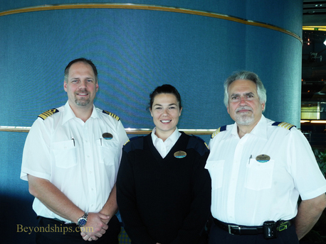 Picture Captain Gus Anderrson, Guest Relations Manager Snezana Katic, Hotel Director Michael Landry of Enchantment of the Seas