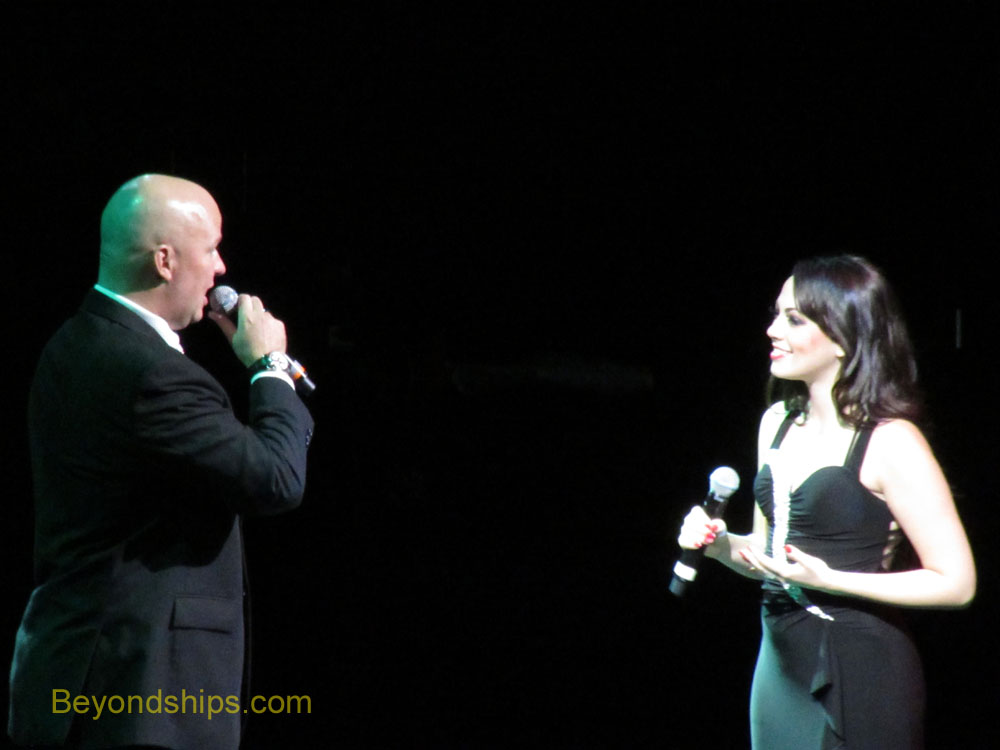 Production cast vocalist Crystal sings with Cruise Director Paul Baya on Celebrity Equinox