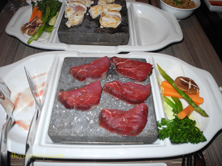 Beef cooking on a volcanic stone, Izumi restaurant, Legend of the Seas
